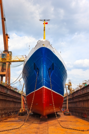commercial docks: Ship in dry dock during the overhaul  Stock Photo