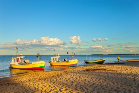 Fishing boats in Sopot with port of Gdansk in the background, Poland   Stock Photo - 18874125