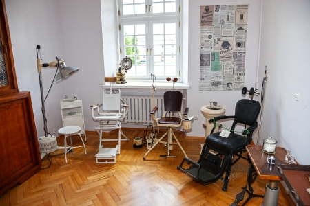 dirty room: Vintage dentist chair and equipment of the last century.