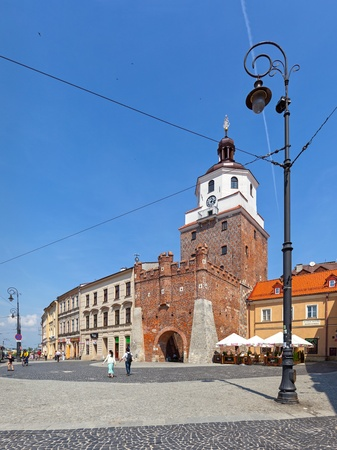People in front Cracow Gate - a symbol of historic Lublin, Poland. Photo taken on: May 11th, 2013