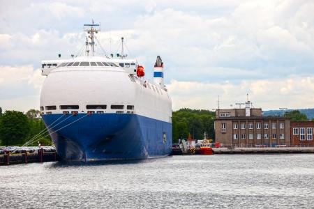 car carrier: Large car carrier ship in port
