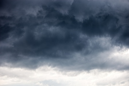 ominous: Dark ominous grey storm clouds - dramatic sky  Stock Photo