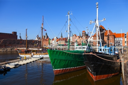 Old fishing boats on the background panorama of Gdansk, Poland  photo