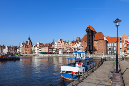 Old boat on the background panorama of Gdansk, Poland  photo