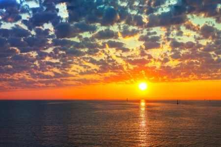 sunset sky: Reflection of the sun at sunrise at sea Stock Photo