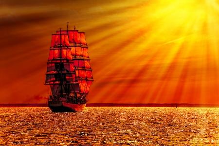 Sailing ship on the sea at sunset skyline  Stock Photo