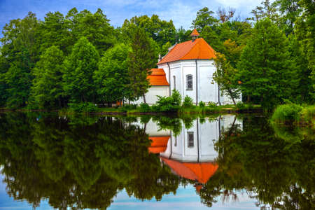 crescent lake: Old church with reflections in the water
