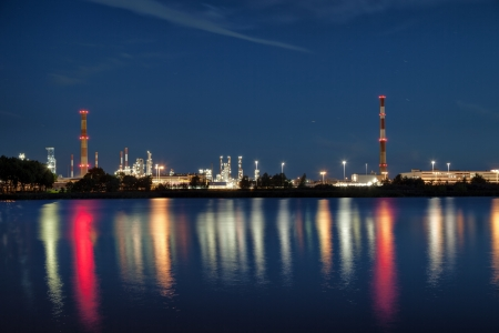 View of large refinery at night in Gdansk, Poland  photo