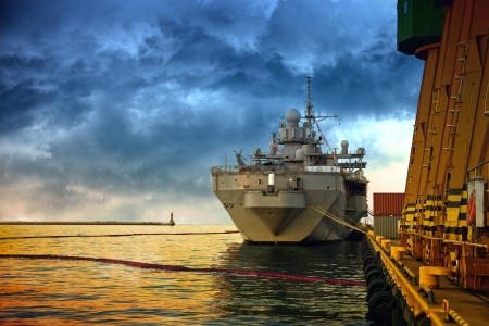 Warship in the port of dramatic scenery