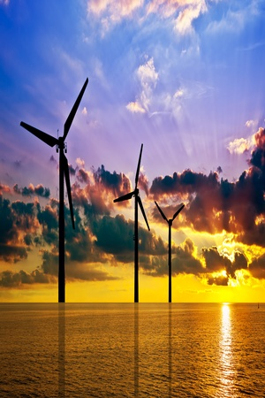 Wind power and colorful sunset over the sea  photo