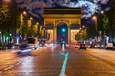 champs: Arc de Triomphe and Champs-Elysees Avenue at night in Paris, France