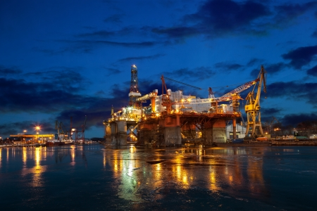 construction platform: Oil rig at night in winter scenery