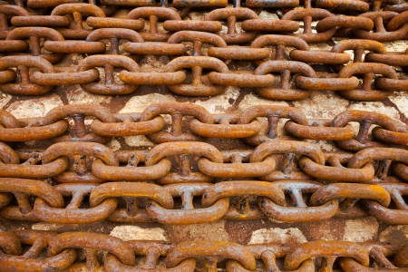 caked: Steel anchor chains caked with rust at an shipyard  Stock Photo