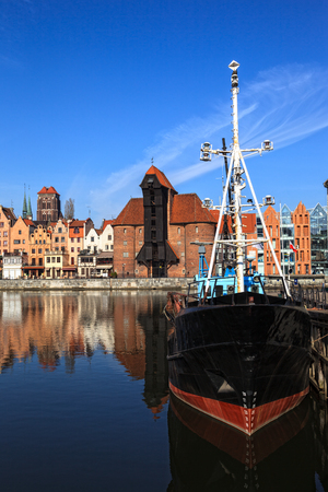 Old fishing boats on the panorama of Gdansk, Poland  photo