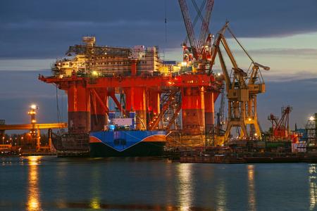 Oil rig at dawn in the shipyard of Gdansk, Poland  photo