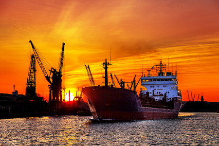 boat lift: Ship and cranes at sunset in port of Gdansk, Poland