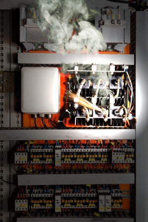 danger box: Overloaded electrical circuit causing electrical short and fire  Stock Photo