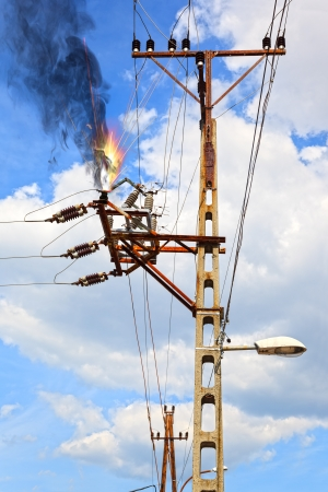 electrical tower: Power pylon - overloaded electrical circuit causing electrical short