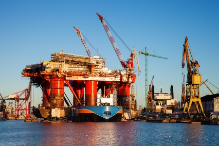 docking: Oil Rig under construction in the shipyard of Gdansk, Poland