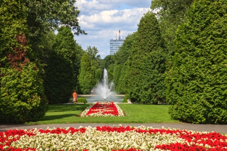 Fountain in city park with flowers in Bialystok, Poland  photo