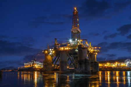 Oil rig at night in winter scenery