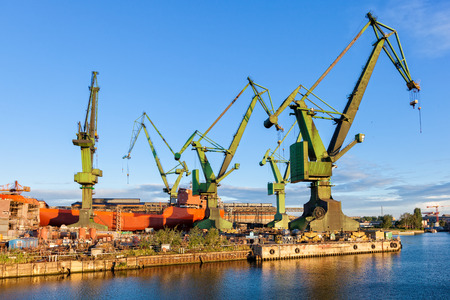 dockyard: Big cranes in yard Gdansk, Poland  Stock Photo