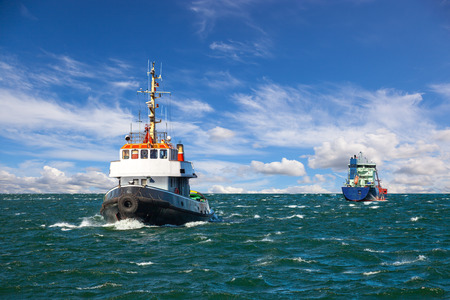 tug boat: Tugboat and sea bulk carrier with pilot boats