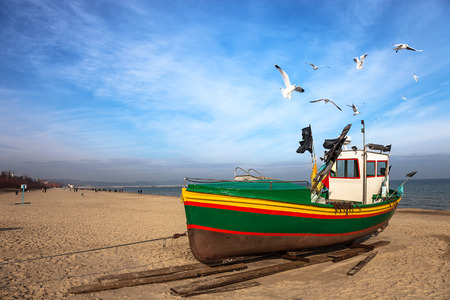 Fishing boat on the beach in Sopot, Poland  photo