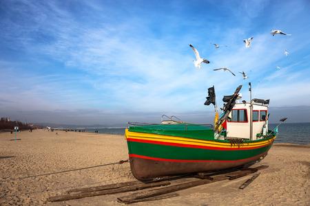 marina bay sand: Fishing boat on the beach in Sopot, Poland