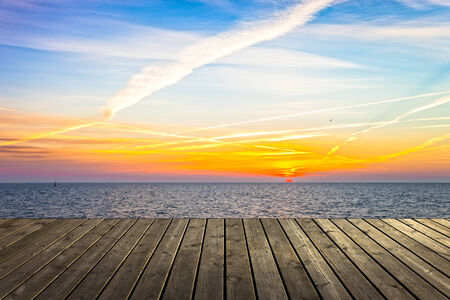 Empty wooden pier at sunrise a beautiful colorful morning  photo