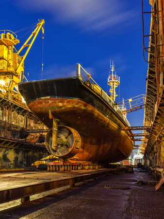 commercial docks: Ship repair in Dry Dock at night