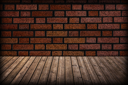 Grunge brick wall and wooden floor in a room   photo