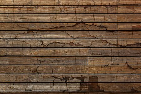 Old cracked wooden plank grunge textured background  photo