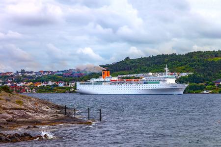 accommodate: STAVANGER, NORWAY - JULY 11  Luxury cruise ship Costa Marina leaves the port of Stavanger, on July 11, 2011 in Stavanger, Norway  The Costa Marina is 174m long has 8 passenger decks that can accommodate 1,025 passenger