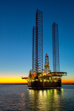 natural gas: Oil drilling rig in sunset time