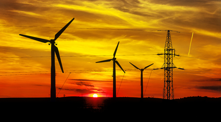 electric power station: High Voltage Power Line and Wind Turbines at sunset