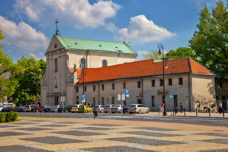 LUBLIN, POLAND - MAY 11  People in front of The Church  St  Peter and Paul, on May 11, 2013 in Lublin, Poland  Lublin Capuchin monastery was founded by Prince Pawel Karol Sanguszko with his wife, Marianne of the Lubomirski family in 1721