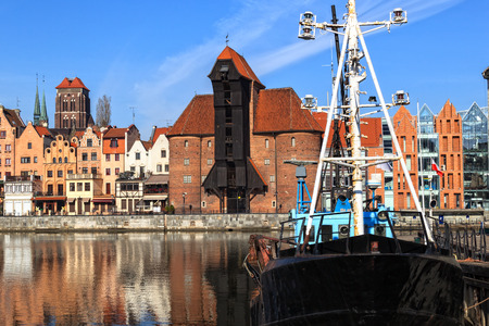 Motlawa River with medieval port crane in Gdansk, Poland  photo