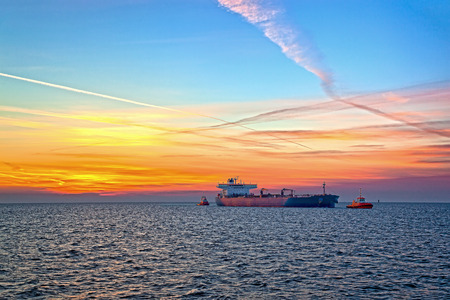 tug boat: Tanker and tugboat on sea early morning just before sunrise
