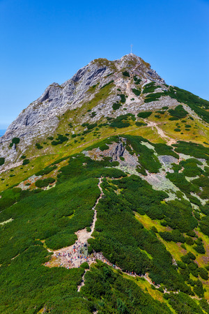 The group of hikers on mountain trail in Tatra Mountains, Poland  photo