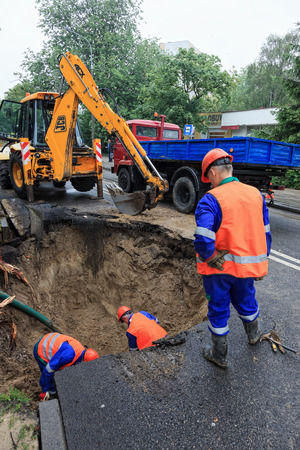 destruct: GDANSK, POLAND - JUNE 22  Workers repairing the damaged road - The consequences of the rupture of the pipeline  June 22, 2012 in Gdansk, Poland  Editorial