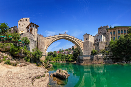 neretva: The Old Bridge in Mostar with emerald river Neretva  Bosnia and Herzegovina  Editorial