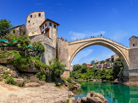 bosnia: The Old Bridge in Mostar with emerald river Neretva  Bosnia and Herzegovina  Editorial