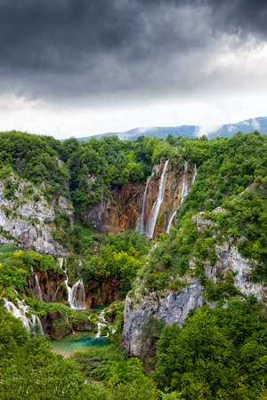 plitvice: Green lake at Plitvice Lakes National Park in Croatia with waterfalls.