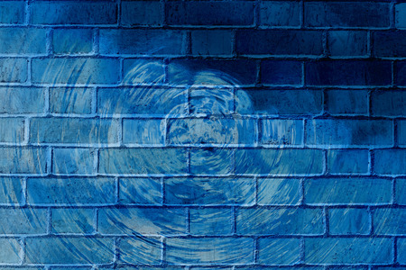 vandalize: Colorful abstract graffiti on a brick wall with rings.