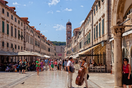 croatia dubrovnik: Tourists walking on the most popular street - Stradun, old town of Dubrovnik, Croatia.