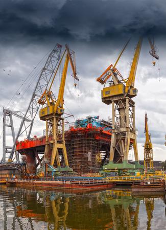 Big industrial crane on a dramatic sky background. photo