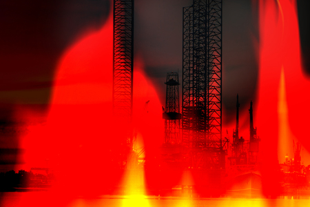 Oil Rig on fire background - abstract view. photo