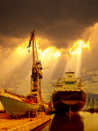 Ship in the port of dramatic scenery. photo