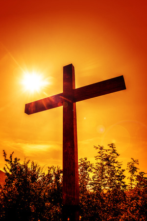 Christian cross in a rays of sun.